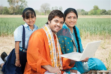 Farmer family using a laptop, Sohna, Haryana, India Stock Photo - Premium Royalty-Free, Code: 630-07071133