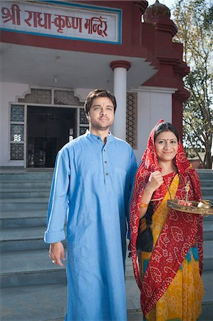 Rural couple standing in front of a temple, Sohna, Haryana, India Stock Photo - Premium Royalty-Free, Code: 630-07071160