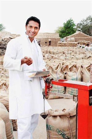 east indian (male) - Man weighing wheat sack on a scale, Anaj Mandi, Sohna, Gurgaon, Haryana, India Stock Photo - Premium Royalty-Free, Code: 630-07071193