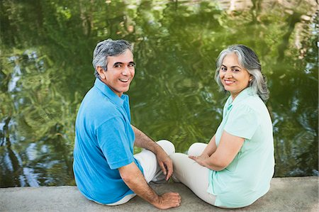 Mature couple sitting in a park at the lakeside and smiling, Lodi Gardens, New Delhi, India Stock Photo - Premium Royalty-Free, Code: 630-07071254