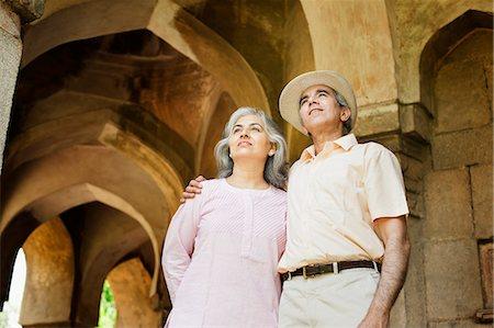 Mature couple standing at a monument, Lodi Gardens, New Delhi, India Stock Photo - Premium Royalty-Free, Code: 630-07071275
