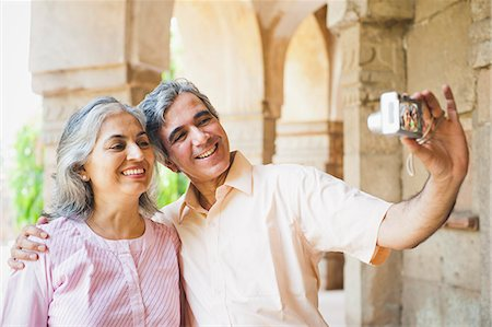 Mature couple taking picture of themselves with a digital camera, Lodi Gardens, New Delhi, India Stock Photo - Premium Royalty-Free, Code: 630-07071280