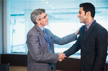 Businessman shaking hands with another businessman Stock Photo - Premium Royalty-Free, Code: 630-07071495