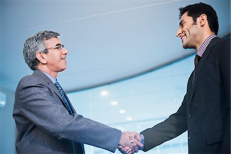 east indian (male) - Businessman shaking hands with another businessman Stock Photo - Premium Royalty-Free, Code: 630-07071496