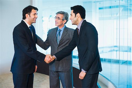Businessman introducing his colleague to another businessman Stock Photo - Premium Royalty-Free, Code: 630-07071502