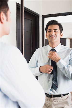 east indian (male) - Businessman getting ready for office Stock Photo - Premium Royalty-Free, Code: 630-07071616
