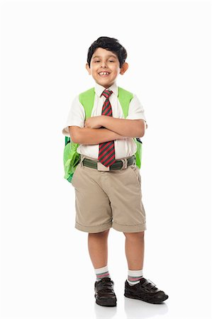 east indian (male) - Schoolboy standing with his arms crossed Stock Photo - Premium Royalty-Free, Code: 630-07071785