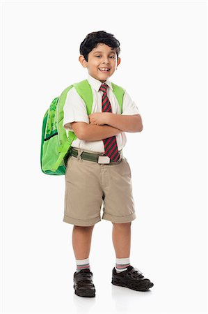 east indian (male) - Schoolboy standing with his arms crossed Stock Photo - Premium Royalty-Free, Code: 630-07071786