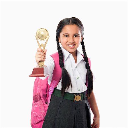 school girl uniforms - Schoolgirl holding a trophy Stock Photo - Premium Royalty-Free, Code: 630-07071794