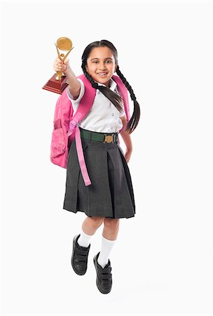 school girl uniforms - Schoolgirl holding a trophy Stock Photo - Premium Royalty-Free, Code: 630-07071795