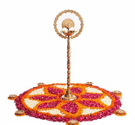 Oil lamps and rangoli of flowers at Onam Stock Photo - Premium Royalty-Free, Code: 630-07071863
