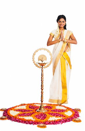 flower greeting - South Indian woman greeting near rangoli of flowers at Onam Stock Photo - Premium Royalty-Free, Code: 630-07071870