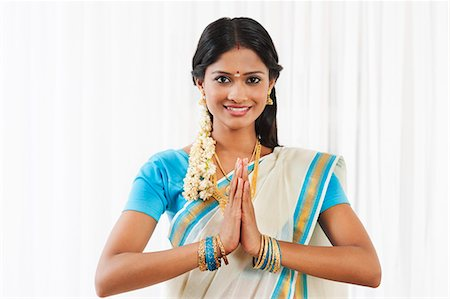 South Indian woman greeting and smiling Stock Photo - Premium Royalty-Free, Code: 630-07071900