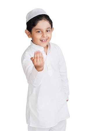 Muslim boy greeting and smiling Stock Photo - Premium Royalty-Free, Code: 630-07071928