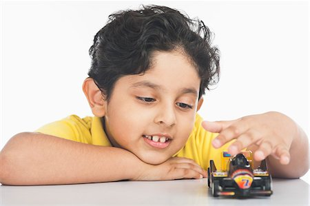 Boy playing with a toy car Stock Photo - Premium Royalty-Free, Code: 630-07071935