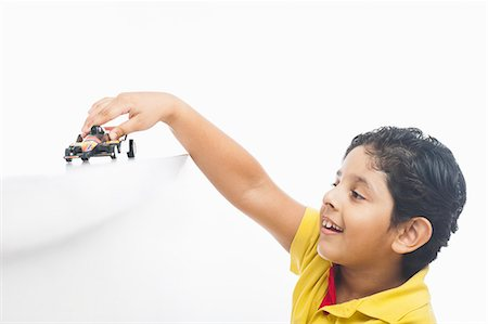 Boy playing with a toy car Stock Photo - Premium Royalty-Free, Code: 630-07071936