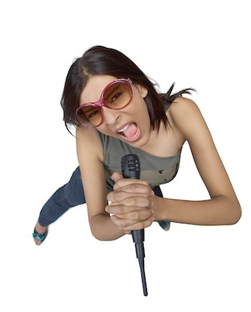 female white background full body - High angle view of a young woman singing into a microphone Stock Photo - Premium Royalty-Free, Code: 630-01191655
