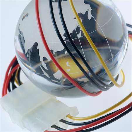 Close-up of a computer cable wrapped around a metal globe Stock Photo - Premium Royalty-Free, Code: 630-01191770