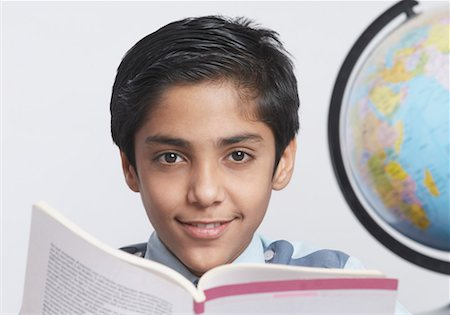preteen  smile  one  alone - Portrait of a schoolboy studying Stock Photo - Premium Royalty-Free, Code: 630-01491567