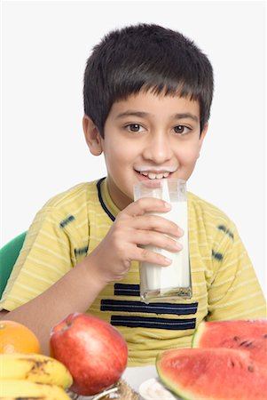 Close-up of a boy drinking a glass of milk Stock Photo - Premium Royalty-Free, Code: 630-01491710