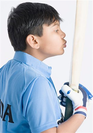 preteen kissing - Side profile of a boy kissing a cricket bat Stock Photo - Premium Royalty-Free, Code: 630-01491794