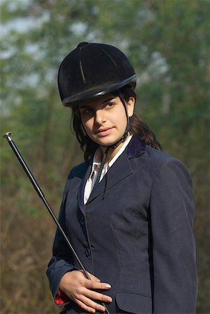 riding crop - Close-up of a female jockey holding a riding crop Stock Photo - Premium Royalty-Free, Code: 630-01491890