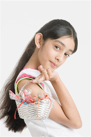 preteen girls bath - Portrait of a girl holding a basket of candy Stock Photo - Premium Royalty-Free, Code: 630-01492251