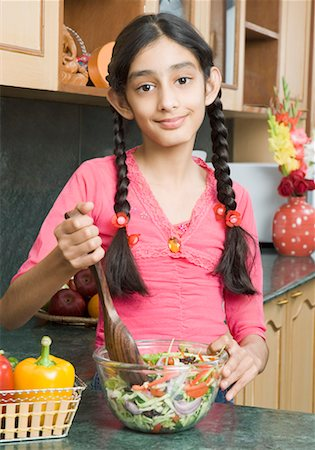 preteen girls bath - Portrait of a girl mixing salad with a wooden spoon Stock Photo - Premium Royalty-Free, Code: 630-01492264