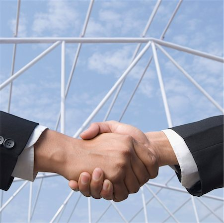 Two businessmen shaking hands Stock Photo - Premium Royalty-Free, Code: 630-01492524