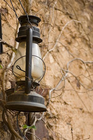 Close-up of a lantern hanging on a wall Stock Photo - Premium Royalty-Free, Code: 630-01708406