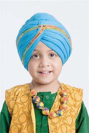 punjabi - Portrait of a boy smiling Stock Photo - Premium Royalty-Free, Code: 630-01708779
