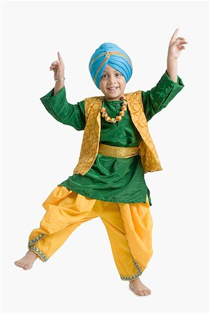 punjabi - Portrait of a boy doing bhangra Stock Photo - Premium Royalty-Free, Code: 630-01708781