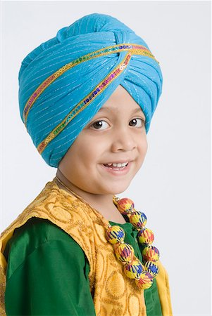 punjabi - Portrait of a boy smiling Stock Photo - Premium Royalty-Free, Code: 630-01708782