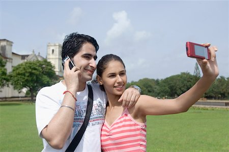Couple taking photograph of themselves near cathedral, Se Cathedral, Goa, India Stock Photo - Premium Royalty-Free, Code: 630-01876707