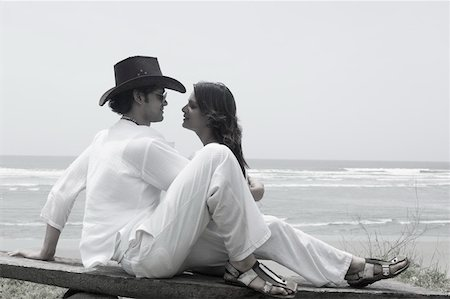 Young couple sitting on the beach Stock Photo - Premium Royalty-Free, Code: 630-01876804