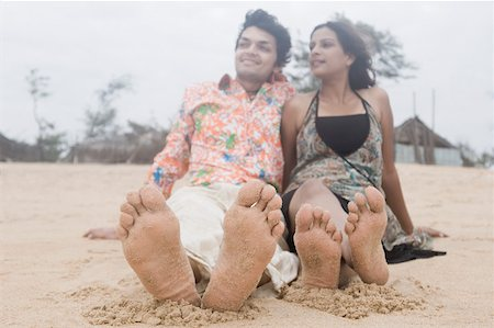 Young couple sitting on the beach Stock Photo - Premium Royalty-Free, Code: 630-01876827