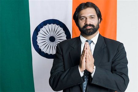 Portrait of a businessman standing in front of an Indian flag Stock Photo - Premium Royalty-Free, Code: 630-01877094