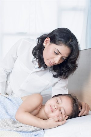 Young woman looking at her daughter sleeping on the bed Stock Photo - Premium Royalty-Free, Code: 630-01877144