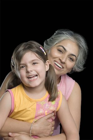 Portrait of a mature woman smiling with her granddaughter Stock Photo - Premium Royalty-Free, Code: 630-01877529