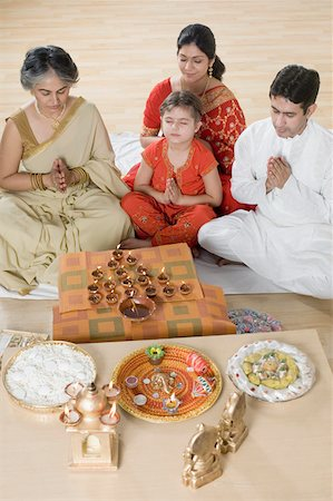 High angle view of a family doing Lakshmi pujan Stock Photo - Premium Royalty-Free, Code: 630-01877611