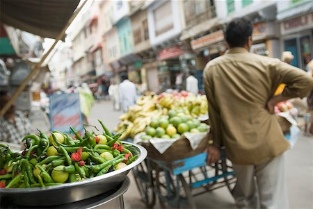 Rear view of a hawker standing near a cart in a street, Ajmer, Rajasthan, India Stock Photo - Premium Royalty-Free, Code: 630-01872126