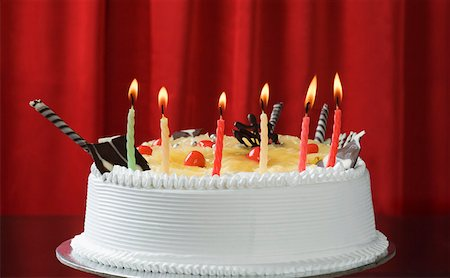 red stick candy - Close-up of lit candles on a birthday cake Stock Photo - Premium Royalty-Free, Code: 630-02219717