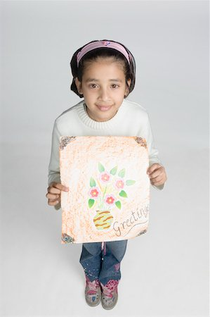 preteen  smile  one  alone - High angle view of a girl showing a drawing Stock Photo - Premium Royalty-Free, Code: 630-02219767
