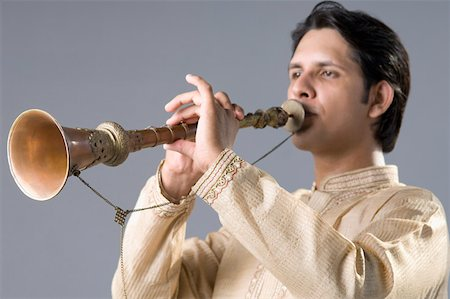 Close-up of a young man playing a clarinet Stock Photo - Premium Royalty-Free, Code: 630-02219977