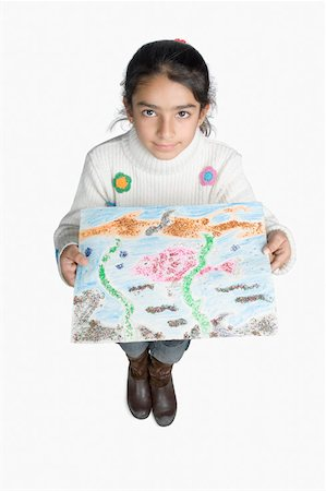High angle view of a girl showing a drawing Stock Photo - Premium Royalty-Free, Code: 630-02220154