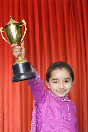 preteen  smile  one  alone - Close-up of a girl holding a trophy Stock Photo - Premium Royalty-Free, Code: 630-02220472