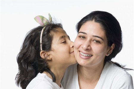 Close-up of a girl kissing her mother and smiling Stock Photo - Premium Royalty-Free, Code: 630-02220526
