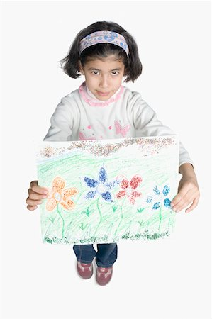High angle view of a girl showing a drawing Stock Photo - Premium Royalty-Free, Code: 630-02220736