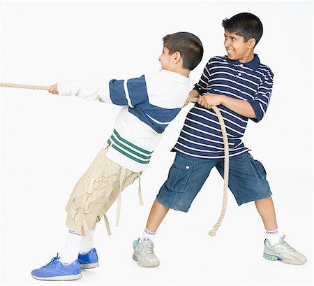 Two boys playing tug-of-war Stock Photo - Premium Royalty-Free, Code: 630-02220770