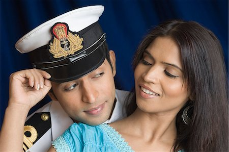 preteen girl boyfriends - Close-up of a navy officer and a teenage girl romancing Stock Photo - Premium Royalty-Free, Code: 630-03479436
